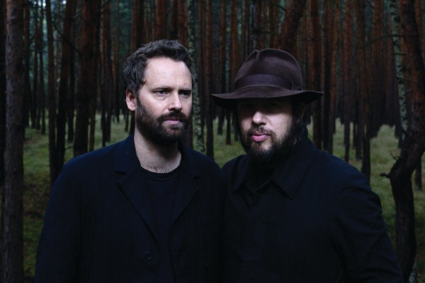 A Winged Victory For The Sullen by Nick and Chloe, two men dressed in black stood in a dark forest