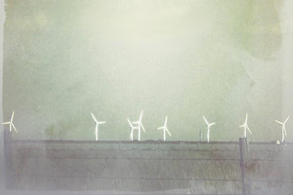 Giulio Aldinucci - Aer, white wind turbines against an aqua green sky