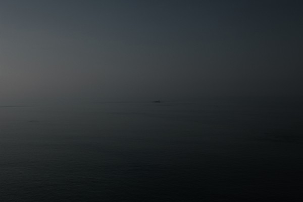 Pascal Savy, Adrift, tiny island in a dark blue sea