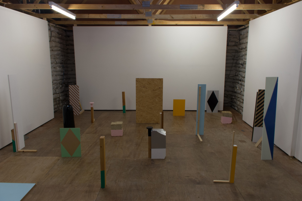 Either Ear, Sarah Hughes installation view, various painted wooden and brick objects
