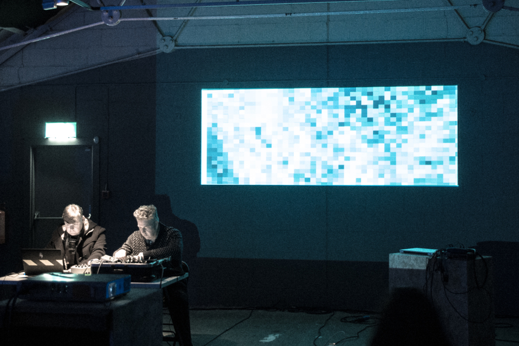 SOUNDKitchen 2014, Nicholas Bullen and Chris Herbert, visuals by Antonio Roberts, two electronic musicians performing with projected pixelated visuals