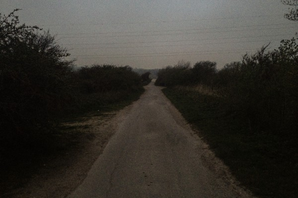 Phil Tomsett, No answers, not even any questions #1, path through dark fields at dusk