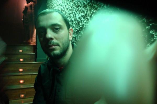 Nigul in dark room with green light