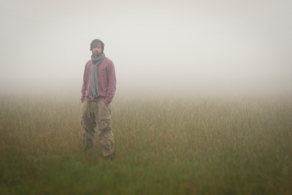 Ryan Teague, Block Boundaries, musician stood in field in the fog