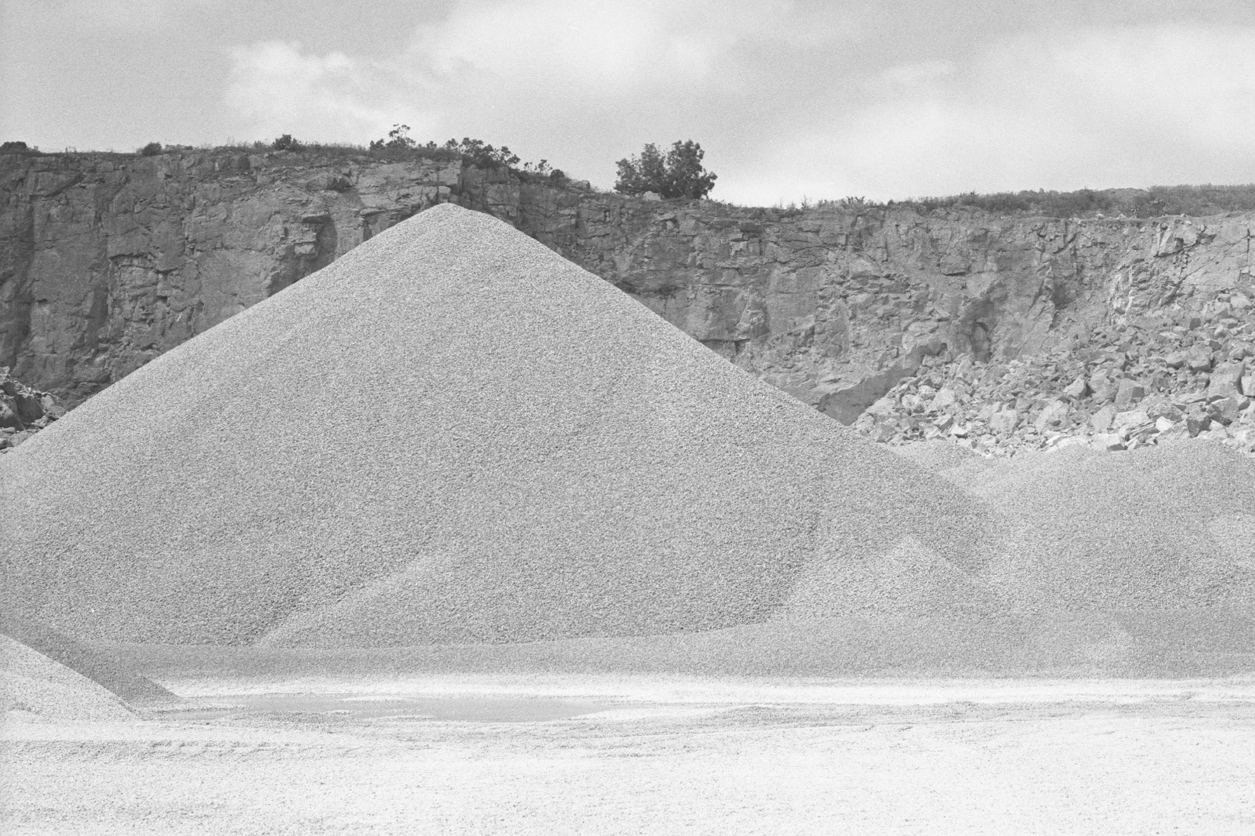 Rie Nakajima, Four Forms - black and white photo of piles of aggregate