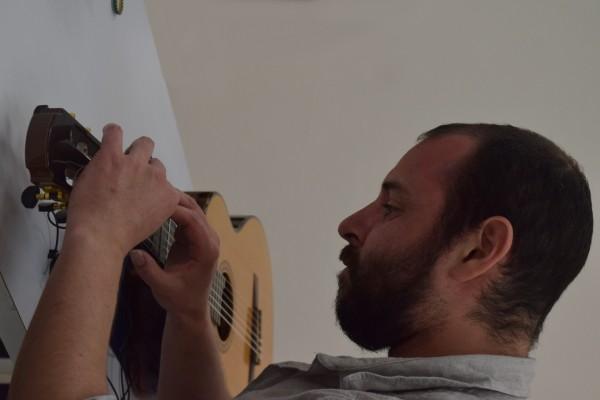 Cristián Alvear - Melody, Silence, musician playing guitar laid flat on table