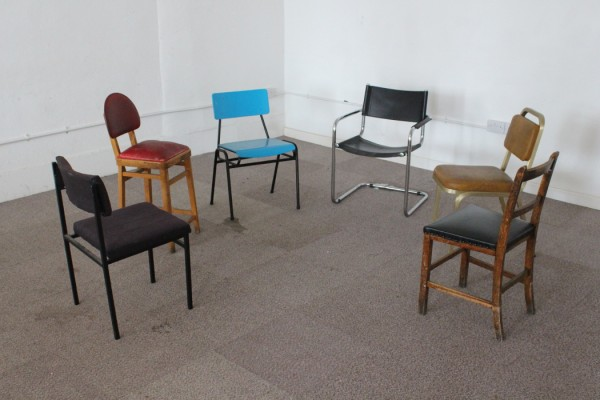 Set Ensemble - Stopcock, group of mismatched old-fashioned chairs in a white room