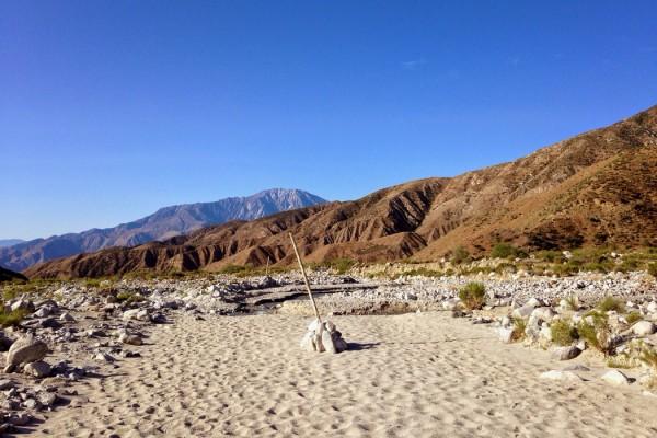 Nat Evans - The Tortoise, pile of stones in a mountain desert