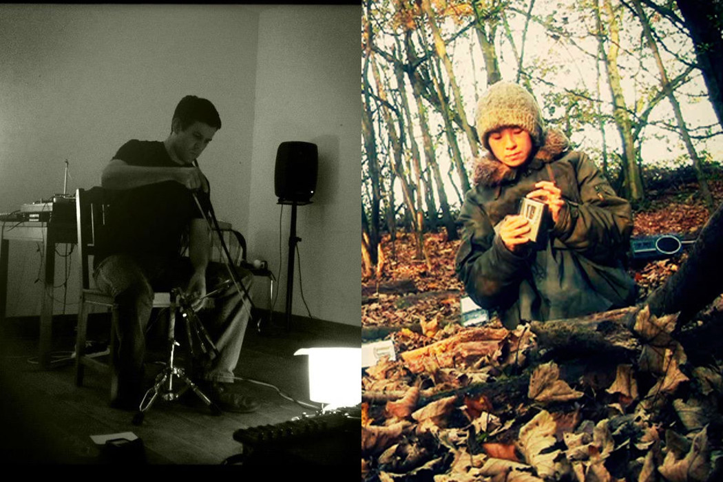 Greg Stuart + Ryoko Akama, Stuart bowing a percussion instrument in room, Akama making recording in forest