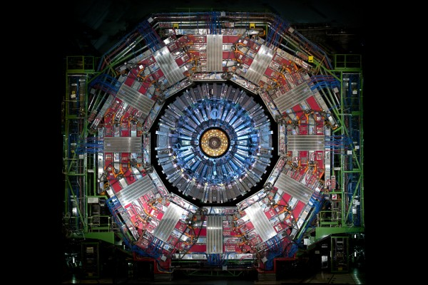 CMS experiment at CERN, very large circular scientific instrument against a black background
