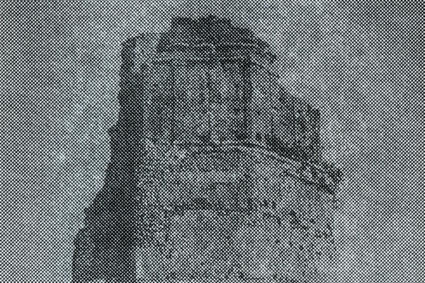 Illogical Harmonies with d'incise, fuzzy low-contrast greyscale image of a ruined tower