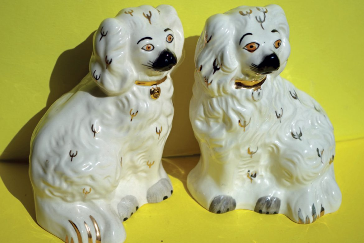 Angharad Davies and Tisha Mukarji - ffansïon fancies, two white china dogs against a bright yellow background