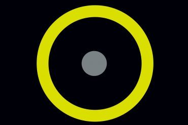 organ, reframed - grey dot surrounded by a yellow ring on a black background