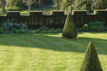 Yann Novak - Ornamentation, trees, lawn, and bushes in an ornamental garden