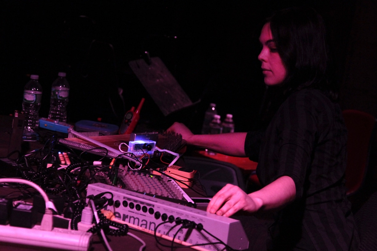 Olivia Block by Bradley Buehring, artist performing with mixer and other electronics