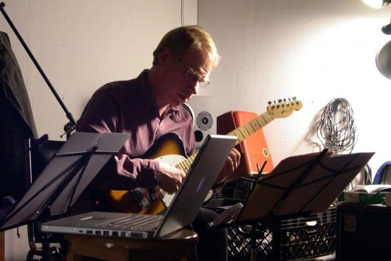 Michael Pisaro performing on electric guitar, photo by Yuko Zama