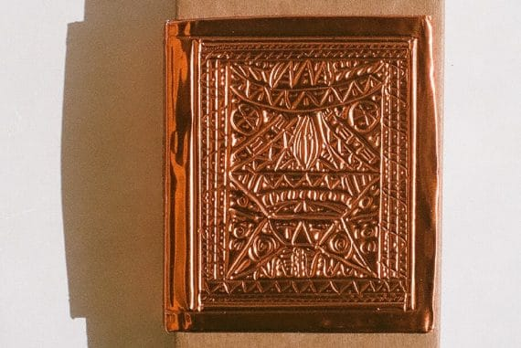 diatribes - Sistere, intricate copper metalwork design depicting a face
