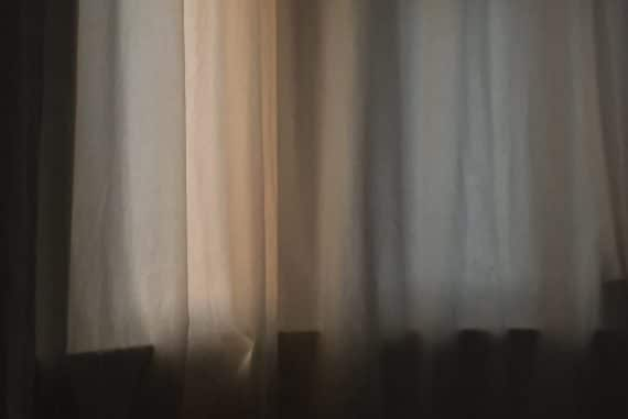 Kostis Kilymis - A Void, curtain with pale light filtering through