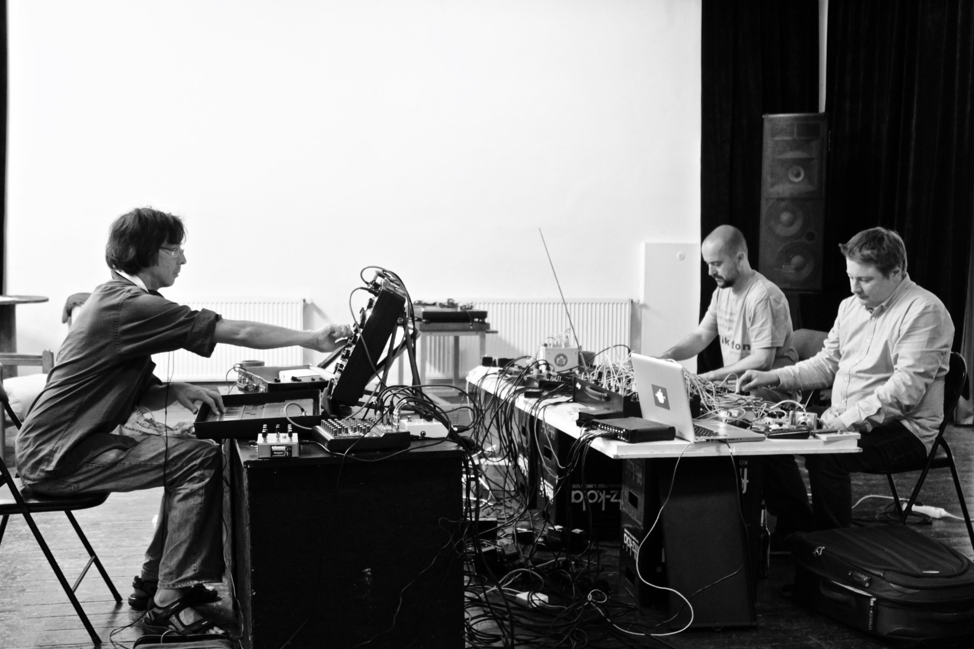Photo of Kurt Leidwart performing with two others on modular synthesizers and electronics