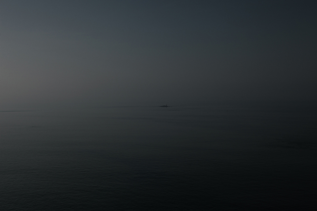 Pascal Savy, Adrift, tiny island in a dark blue sea