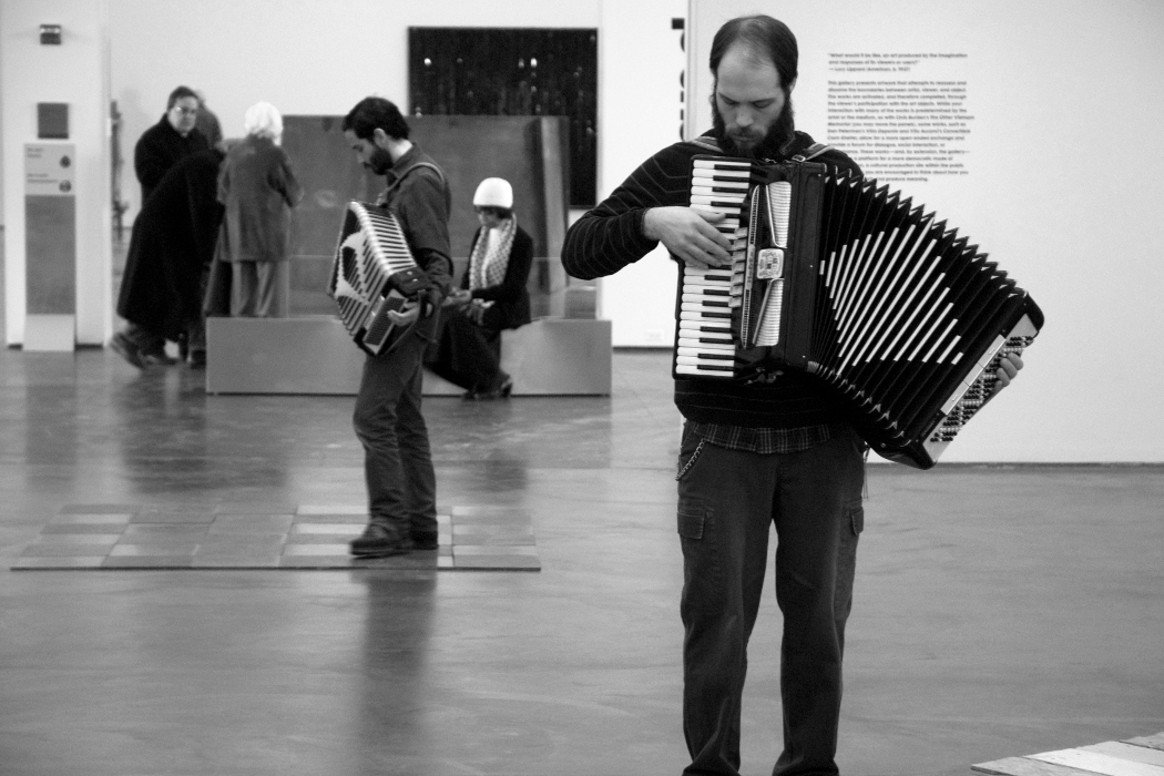 Coppice - Vinculum (Coincidence), two accordionists stood in a modern art gallery
