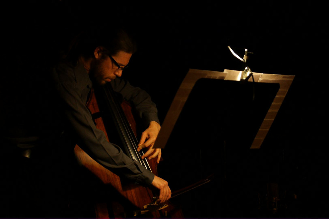 Ensemble et cetera - Even the Light Itself Falls, Scott Worthington playing double bass with score open in front of him