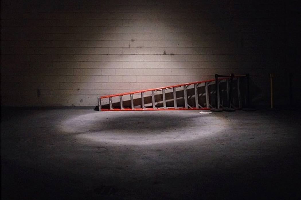 Sentimental Machines - Less, ladder lying on the floor in a dark warehouse room