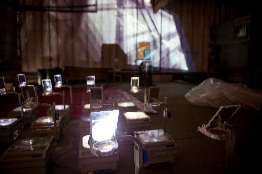 Clots, dark room full of overhead projectors