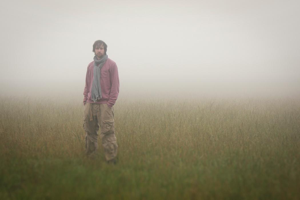 Ryan Teague, Block Boundaries, musician stood in field in the fog