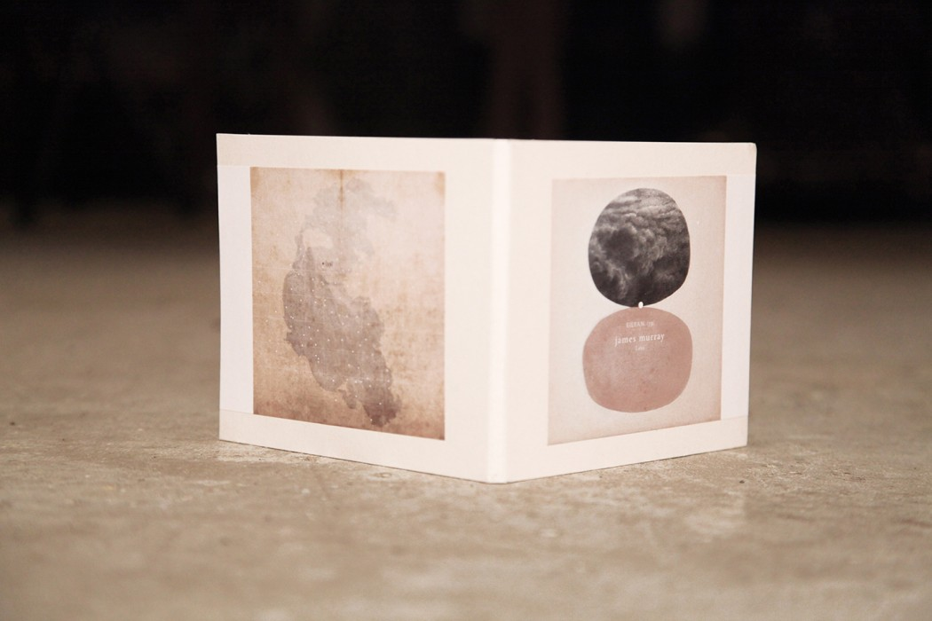 James Murray - Loss, CD cover with clouds, a pink stone, a faded map