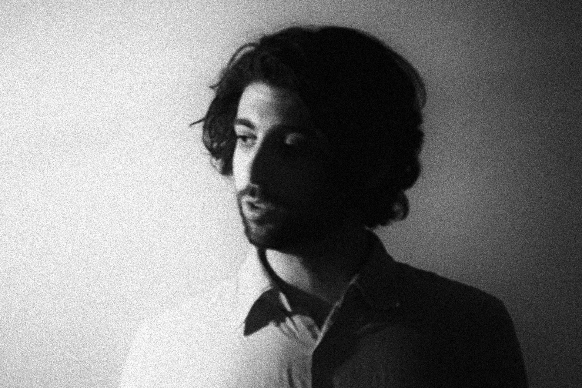 Adam Basanta by Pablo Riquelme, black-and-white photo of artist