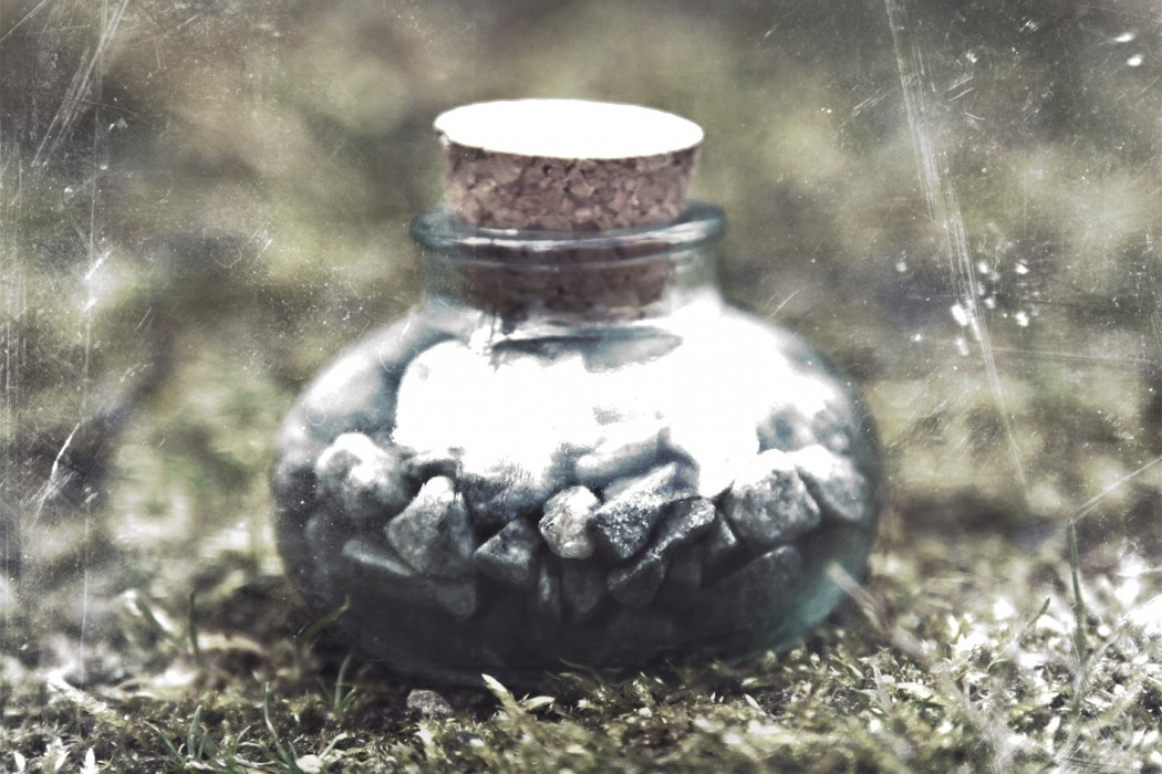 Bill Seaman - F (noir), pebbles in a corked bell jar