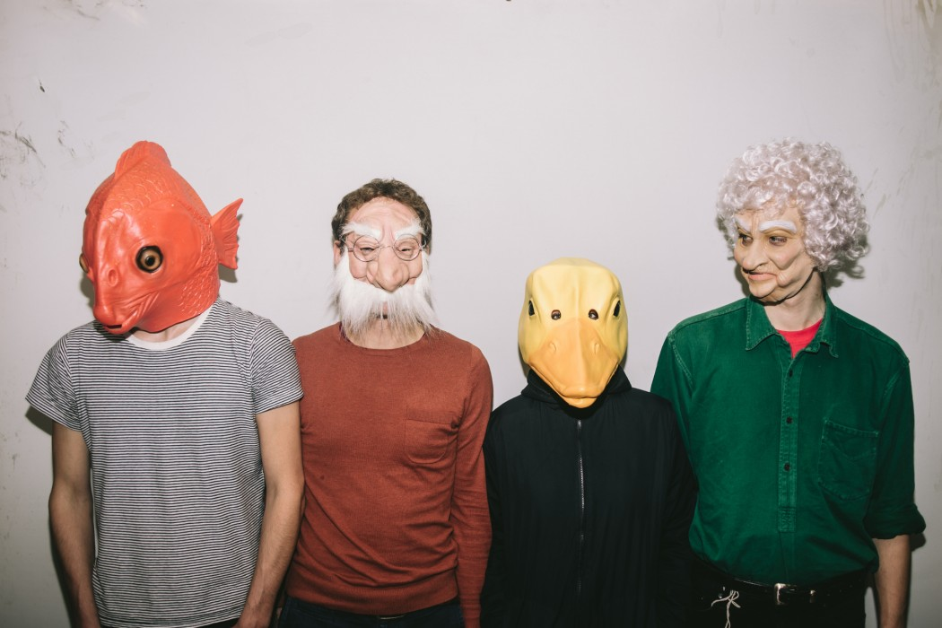 ACM + Joe Snape - four people with various rubber masks