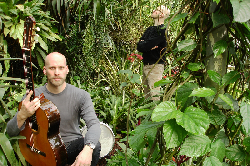 Christian Buck and Christian Wolfarth, two musicians in dense green forest