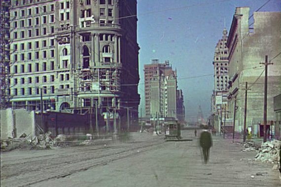 Cem Güney - three dots, a jaw, and a cul de sac, old photo of Instanbul showing tower blocks and a tramline