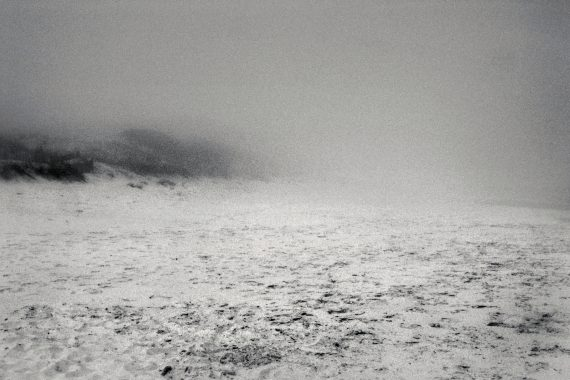 Sergio Merce - be nothing, black and white image of an empty beach covered in haze