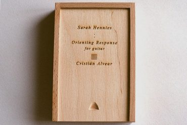 Hennies / Alvear - Orienting Response, engraved wooden box containing the album cassette