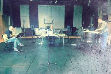 Michael Pisaro - Resting in a Fold of the Fog, faded blue photo of the musicians recording the album