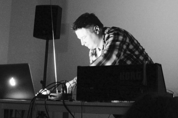 Photo of Kurt Leidwart performing with synthesizer and laptop.