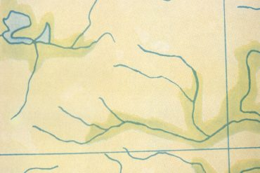 Ambient@40 conference, green map with rivers from the cover of Brian Eno's Ambient 1: Music for Airports.