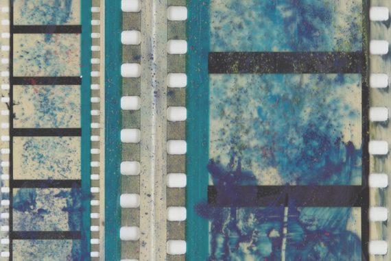 Grisha Shakhnes - ARCS, blue-tinted closeup of celluloid film