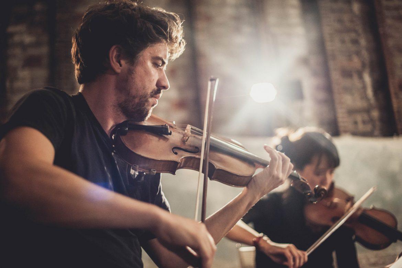 Phaedra Ensemble, two violinists performing.