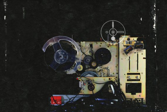 Michael Cutting - STILLS, reel film projector with a heap of tape against a black background.