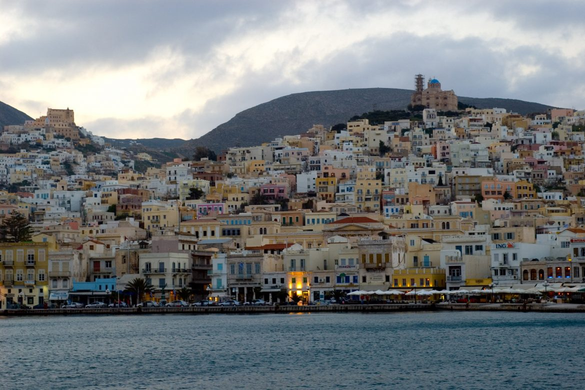 Michael Pisaro - Shades of Eternal Night, image of buildings lining the shore of the Aegean Sea in Ermoupoli, Syros, by Ross Berteig.